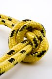 Knot with clipping path. Knot on a yellow-and-black rope on white background with embedded clipping path Royalty Free Stock Photo
