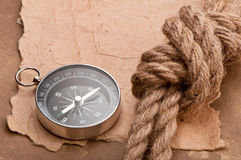 Knot, a compass and a paper Stock Image
