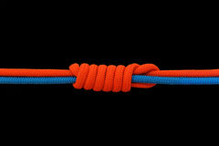Knot on a cord. On a dark background stock photos