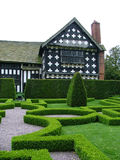Knot garden. A beautiful knot garden in front of a timbered hall stock image