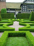 A knot garden. A beautiful knot garden in front of an old timbered hall Stock Images