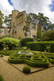 Knot garden in castle. Topiary knot garden with Arabian style fountain in the grounds of historic estate Stock Photos