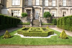 Knot garden in front of an entrance  Stock Images