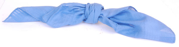 Knot in handkerchief. A blue fabric handkerchief with a knot as a reminder not to forget something. Image isolated on white studio background Stock Images
