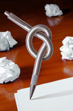 Knot on Pen. Pen with knot and blank white sheets of paper - Creativity crisis concept Stock Photos