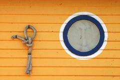 Knot and porthole window Stock Photos