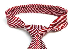 A knot red tie Royalty Free Stock Images