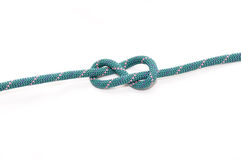 Knot on rope. Figure eight knot on white Royalty Free Stock Image