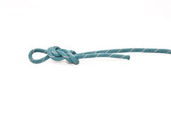 Knot on rope. Follow through figure eight knot isolated on white Stock Photography