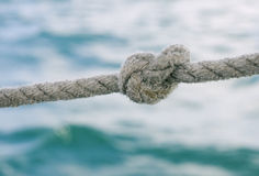 Knot on a rope. Against sea water Royalty Free Stock Images