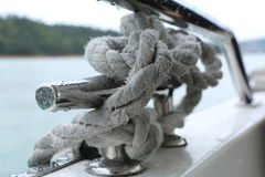 Knot Rope on Handrail Yacht. Means as if unsolved problem or stress Royalty Free Stock Photos