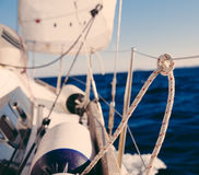 Knot on rope and sailboat crop Stock Photography