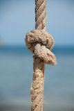 Knot on the rope and sea Stock Photos