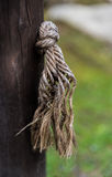 Knot. A rope knot through a wooden post Royalty Free Stock Images