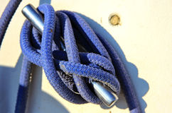 Knot on a sail boat. Close-up nautical knot rope on sail boat Stock Image