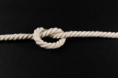 Knot Tied in a Length of White Rope Stock Image