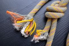 A knot tied on a sailing line. A rope for sailors and travelers on the table stock photography
