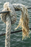 Knot To Thick Rope. Knot on old industrial rope Royalty Free Stock Photo