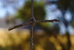 Knot of torn old rope. With blurred natural background royalty free stock image