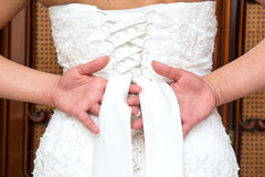 Knot in wedding dress Stock Photos