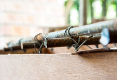 Knot Wire. A bar of Steel is tied with a smaller wire Royalty Free Stock Photo