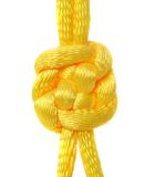 Knot of yellow silk lace. Royalty Free Stock Images