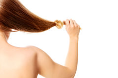 Knoten des blonden Haares lokalisiert auf weißem Hintergrund Lizenzfreies Stockbild