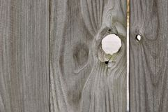 Knothold in Board Fence Royalty Free Stock Image