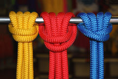 Knots. Three knots from colour cords on a metal stick royalty free stock image