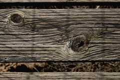 Knots in weathered wood slat Stock Photos