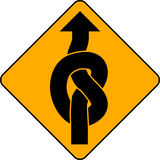 Knotted arrow sign. A yellow road sign with a knotted arrow pointing upwards Royalty Free Stock Photography