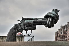 The knotted gun of United Nations. In the access to building of the United Nations in New York is this sculpture of a gun that has made a knot to symbolize peace royalty free stock photo