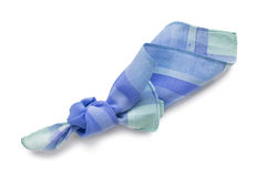 Knotted handkerchief. Knotted blue cotton handkerchief on white background Royalty Free Stock Photos