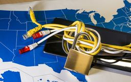 Knotted net cable around a padlock over a US map. Suitable for concepts as net neutrality regulations in the USA, Internet Freedom Preservation Act and Open Royalty Free Stock Photography