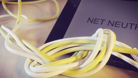 Knotted net cable and a smartphone. With the words Net Neutrality on screen. Suitable for concepts as net neutrality regulations, Internet Freedom Preservation stock footage