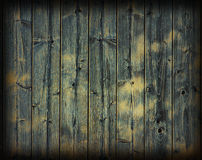 Knotted oak planks background. A textured grungr background of blue painted wood planks wall royalty free stock image