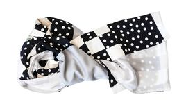 Knotted patchwork scarf from polka dots fabric stock image