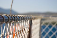 A knotted rope mesh netting fencing protection for safety on a boat royalty free stock photography