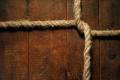 Knotted Rope On Wood Royalty Free Stock Photo