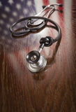 Knotted Stethoscope with American Flag Reflection on Table Royalty Free Stock Images