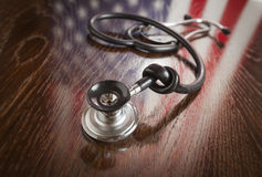 Knotted Stethoscope with American Flag Reflection on Table Stock Photography
