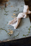 Knotted towel on rustic blue scraped wooden table with little thyme Stock Photo