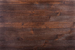Knotty textured dark wood Royalty Free Stock Images