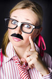 Know all business person with answer to question. Odd female business scientist wearing moustache gesturing knowledge to the solution when answering a complex Stock Photo