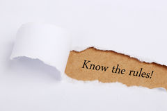 Know the rules!. Know the rules concept written on brown torn paper Stock Image