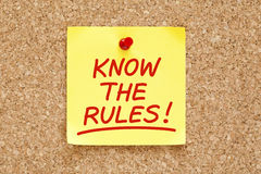 Know The Rules Sticky Note. Know The Rules written on yellow sticky note with red marker Stock Photo