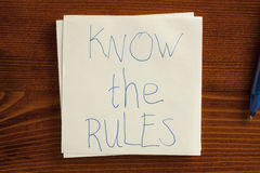 Know the rules written on a note Royalty Free Stock Photography