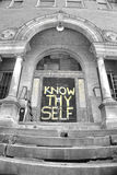 Know thyself. Abandoned School with Bible lyrics know thyself written on the door Stock Photography