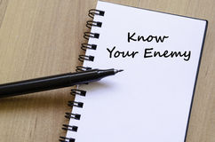 Know your enemy write on notebook. Know your enemy text concept write on notebook with pen Royalty Free Stock Image