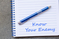 Know your enemy write on notebook. Know your enemy text concept write on notebook with pen Royalty Free Stock Photos